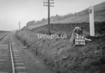 SD990541K, Man marking Ordnance Survey minor control revision point with an arrow in 1950s