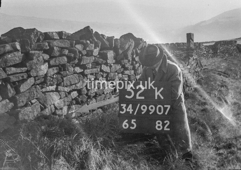 SD990752K, Man marking Ordnance Survey minor control revision point with an arrow in 1950s