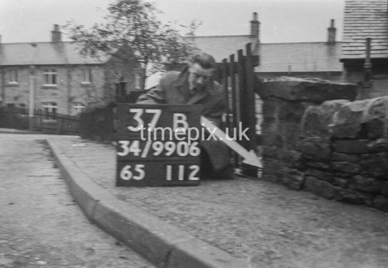 SD990637B1, Man marking Ordnance Survey minor control revision point with an arrow in 1950s