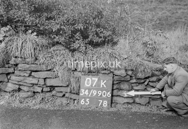 SD990607K, Man marking Ordnance Survey minor control revision point with an arrow in 1950s