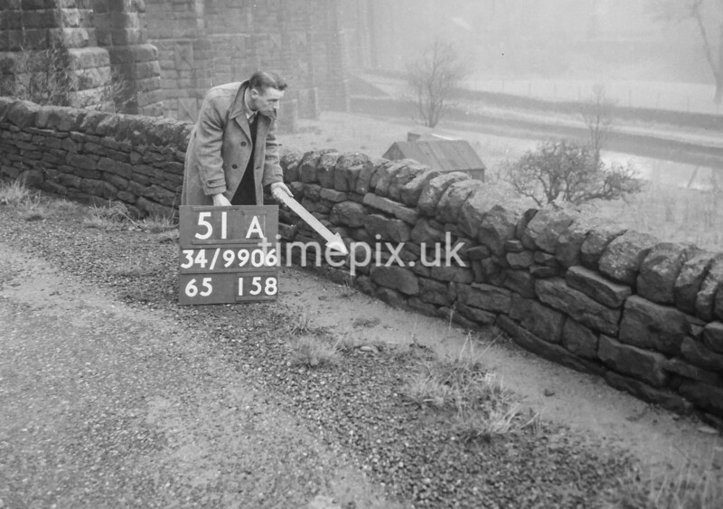 SD990651A, Man marking Ordnance Survey minor control revision point with an arrow in 1950s