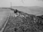 SD980666A, Man marking Ordnance Survey minor control revision point with an arrow in 1950s