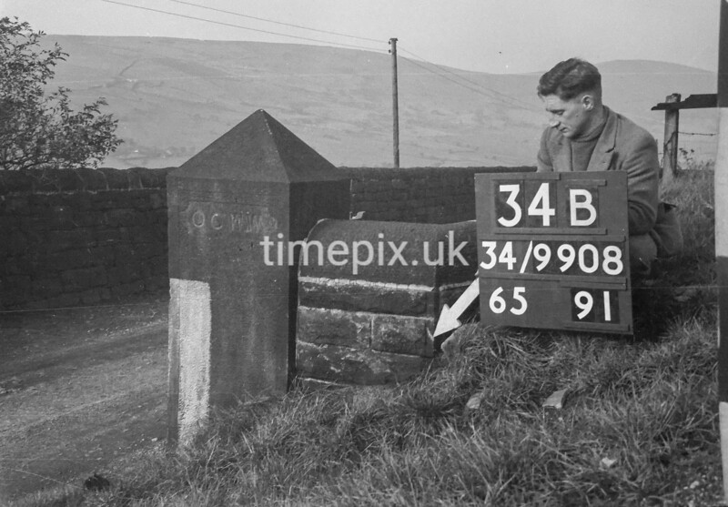 SD990834B2, Man marking Ordnance Survey minor control revision point with an arrow in 1950s