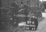 SD990589B, Man marking Ordnance Survey minor control revision point with an arrow in 1950s