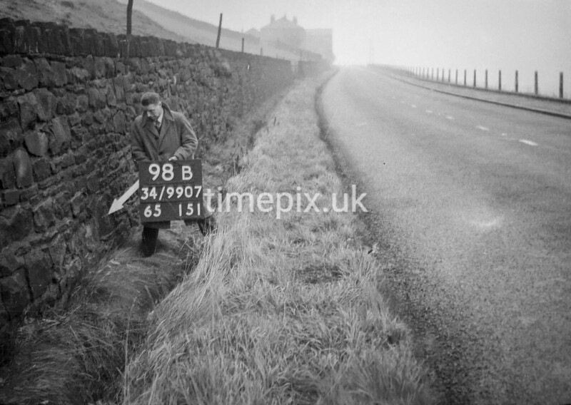 SD990798B, Man marking Ordnance Survey minor control revision point with an arrow in 1950s
