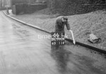 SD990666L1, Man marking Ordnance Survey minor control revision point with an arrow in 1950s