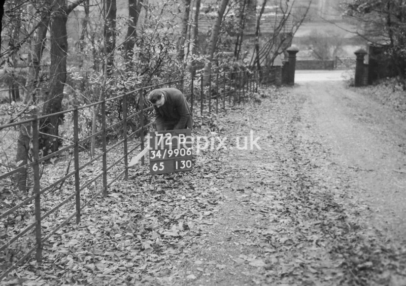 SD990672B, Man marking Ordnance Survey minor control revision point with an arrow in 1950s