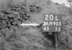 SD990520L, Man marking Ordnance Survey minor control revision point with an arrow in 1950s