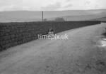 SD990846B2, Man marking Ordnance Survey minor control revision point with an arrow in 1950s