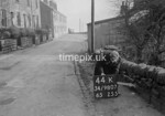 SD980744K, Man marking Ordnance Survey minor control revision point with an arrow in 1950s