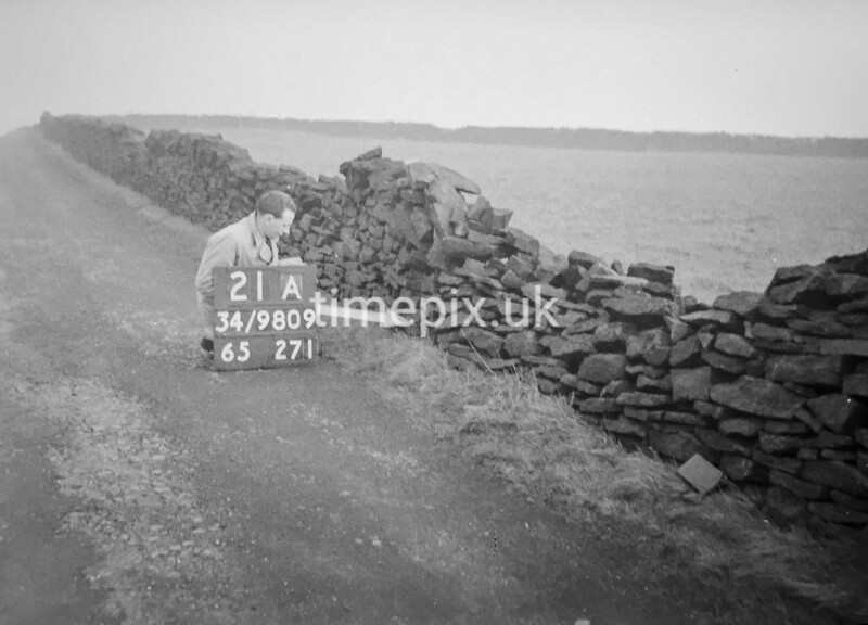 SD980921A, Man marking Ordnance Survey minor control revision point with an arrow in 1950s