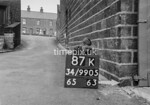 SD990587K, Man marking Ordnance Survey minor control revision point with an arrow in 1950s