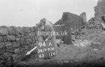 SD990894A, Man marking Ordnance Survey minor control revision point with an arrow in 1950s