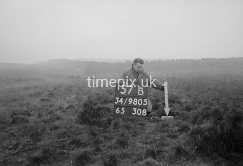 SD980557B2, Man marking Ordnance Survey minor control revision point with an arrow in 1950s