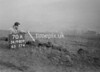 SD980970A, Man marking Ordnance Survey minor control revision point with an arrow in 1950s