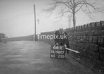 SD980766K, Man marking Ordnance Survey minor control revision point with an arrow in 1950s