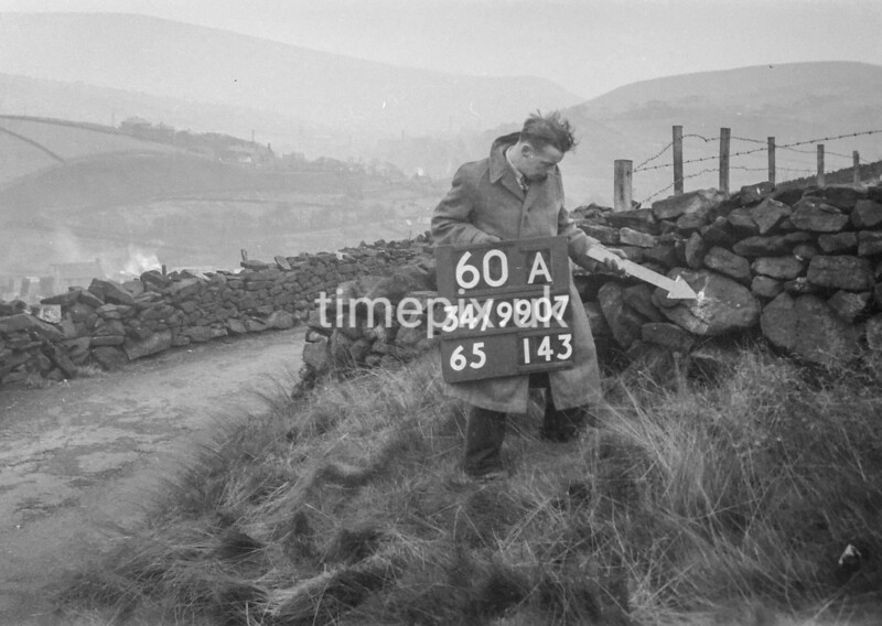 SD990760A1, Man marking Ordnance Survey minor control revision point with an arrow in 1950s