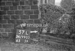 SD990557L, Man marking Ordnance Survey minor control revision point with an arrow in 1950s