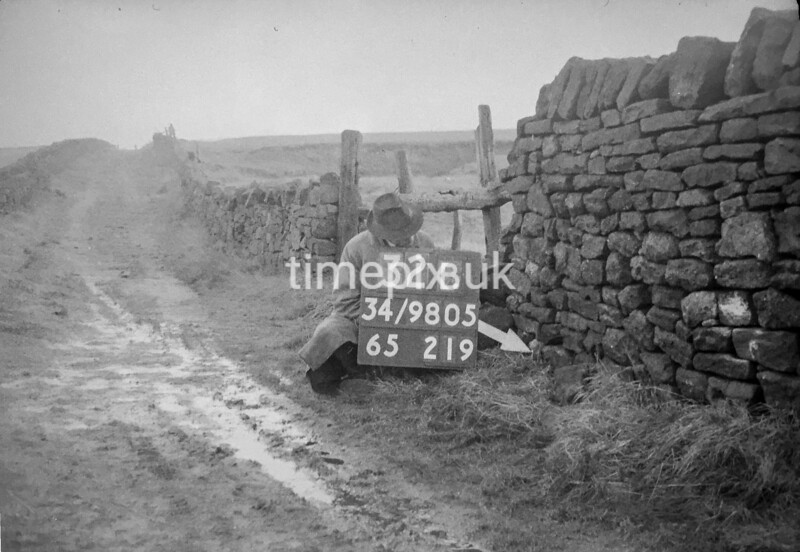 SD980532B, Man marking Ordnance Survey minor control revision point with an arrow in 1950s