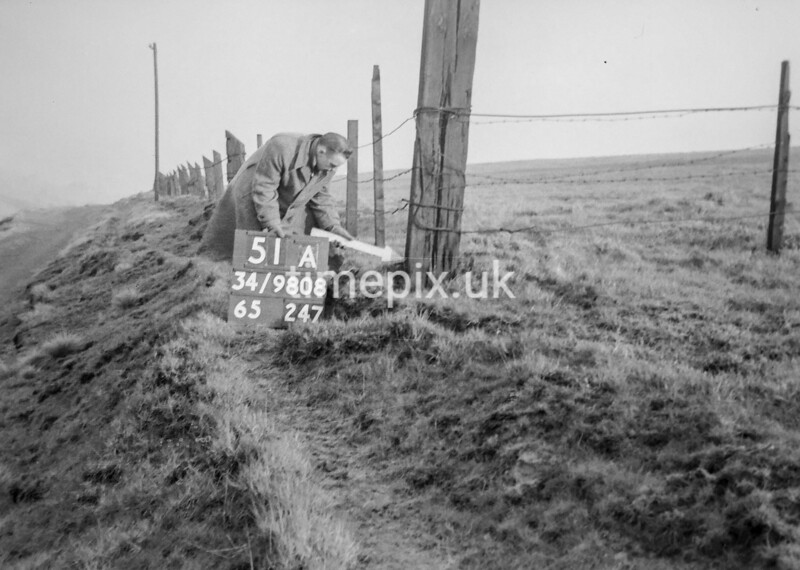 SD980851A, Man marking Ordnance Survey minor control revision point with an arrow in 1950s