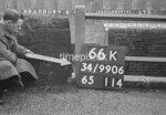 SD990666K, Man marking Ordnance Survey minor control revision point with an arrow in 1950s