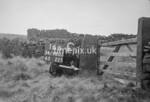 SD980516B, Man marking Ordnance Survey minor control revision point with an arrow in 1950s