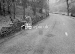 SD980674L, Man marking Ordnance Survey minor control revision point with an arrow in 1950s
