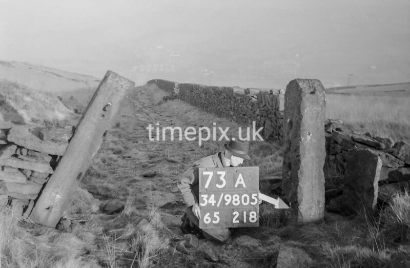 SD980573A1, Man marking Ordnance Survey minor control revision point with an arrow in 1950s