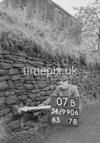 SD990607B, Man marking Ordnance Survey minor control revision point with an arrow in 1950s