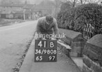 SD980841B, Man marking Ordnance Survey minor control revision point with an arrow in 1950s