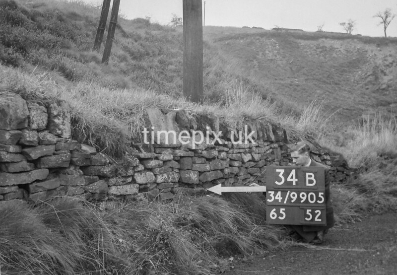 SD990534B, Man marking Ordnance Survey minor control revision point with an arrow in 1950s