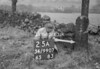 SD990725A, Man marking Ordnance Survey minor control revision point with an arrow in 1950s
