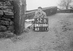 SD990652B1, Man marking Ordnance Survey minor control revision point with an arrow in 1950s