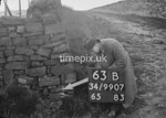 SD990763B, Man marking Ordnance Survey minor control revision point with an arrow in 1950s