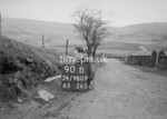 SD980990B, Man marking Ordnance Survey minor control revision point with an arrow in 1950s
