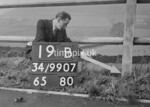 SD990719B, Man marking Ordnance Survey minor control revision point with an arrow in 1950s