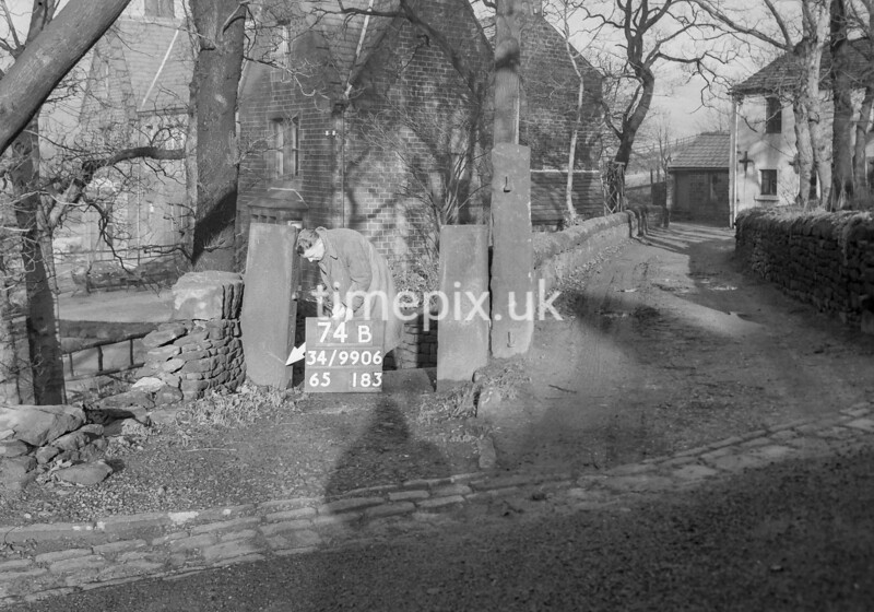 SD990674B2, Man marking Ordnance Survey minor control revision point with an arrow in 1950s