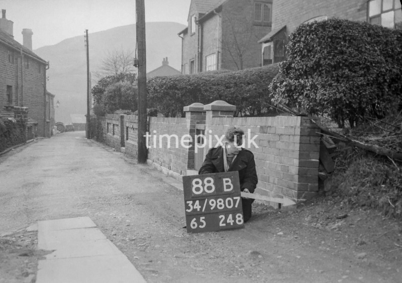SD980788B, Man marking Ordnance Survey minor control revision point with an arrow in 1950s