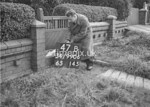 SD990647B, Man marking Ordnance Survey minor control revision point with an arrow in 1950s