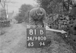 SD980881B, Man marking Ordnance Survey minor control revision point with an arrow in 1950s