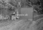 SD990602A1, Man marking Ordnance Survey minor control revision point with an arrow in 1950s