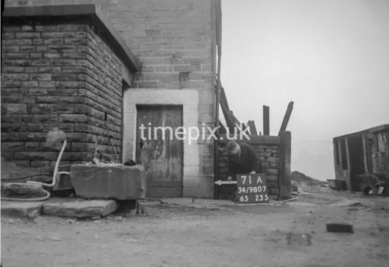 SD980771A, Man marking Ordnance Survey minor control revision point with an arrow in 1950s
