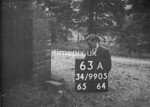 SD990563A, Man marking Ordnance Survey minor control revision point with an arrow in 1950s