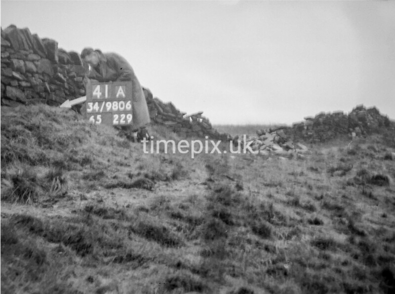 SD980641A, Man marking Ordnance Survey minor control revision point with an arrow in 1950s