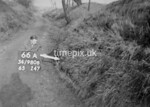 SD980866A, Man marking Ordnance Survey minor control revision point with an arrow in 1950s