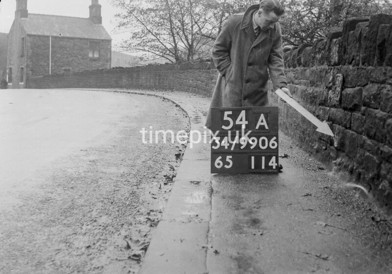SD990654A, Man marking Ordnance Survey minor control revision point with an arrow in 1950s