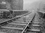 SD980673K, Man marking Ordnance Survey minor control revision point with an arrow in 1950s