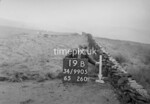 SD990519B, Man marking Ordnance Survey minor control revision point with an arrow in 1950s