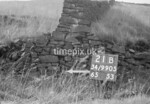 SD990521B, Man marking Ordnance Survey minor control revision point with an arrow in 1950s