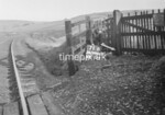 SD990671B, Man marking Ordnance Survey minor control revision point with an arrow in 1950s
